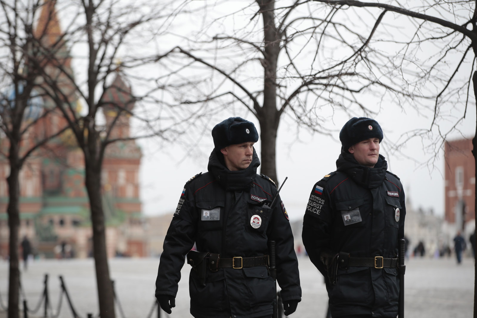 Tourist police officers patrol the Red Square in Moscow, Russia, Tuesday, March 22, 2016. Authorities in Europe have tightened security at airports, on subways, at the borders and on city streets after deadly attacks Tuesday on the Brussels airport and its subway system. (AP Photo/ Pavel Golovkin)