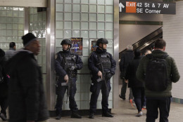 A pair of New York City Police Transit officers patrol in New York the subway station in Times Square,  Tuesday, March 22, 2016. Authorities are increasing security throughout New York City following explosions at the airport and subway system in the Belgian capital of Brussels.  (AP Photo/Richard Drew)