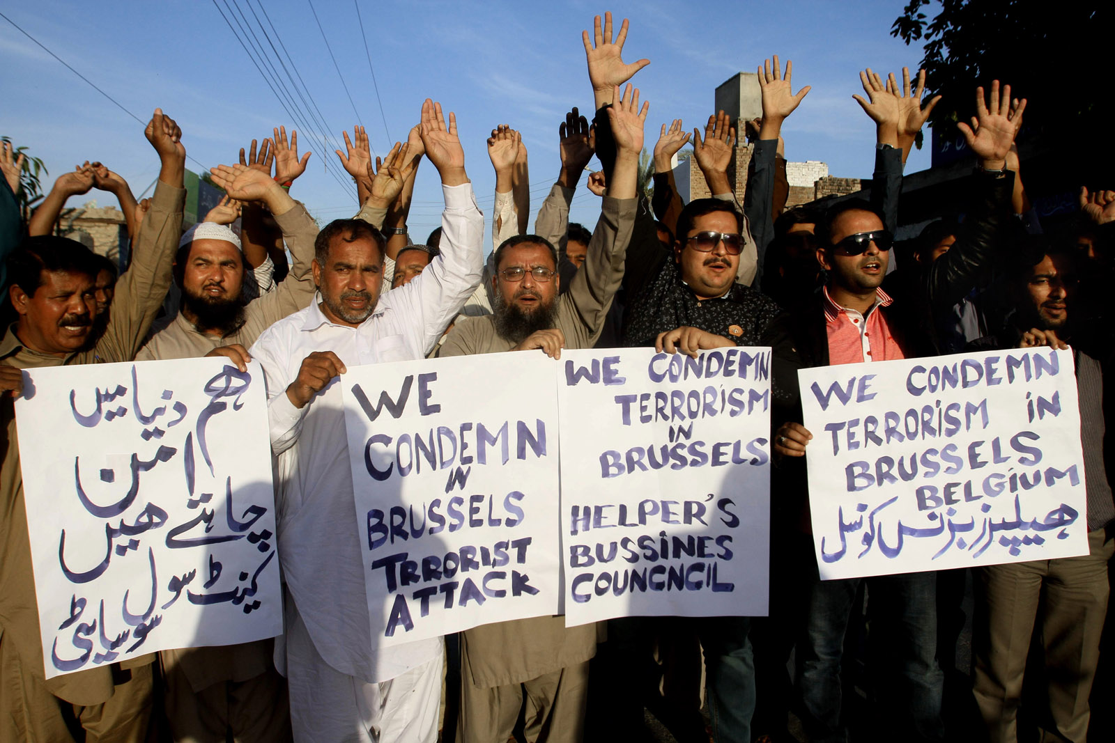 "Activists of Pakistani civil society chant slogans during a rally to condemn the Brussels attack, in Multan, Pakistan, Tuesday, March 22, 2016. Explosions, at least one likely caused by a suicide bomber, rocked the Brussels airport and subway system Tuesday, prompting a lock down of the Belgian capital and heightened security across Europe. Placard at left reads, ""we want peace in the world."" (AP Photo/Asim Tanveer)"