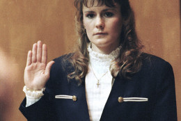 FILE - In this March 18, 1991 file photo, Pamela Smart, 23, takes the oath before sitting in the witness stand in Rockingham County Superior Court in Exeter, N.H.  William  Flynn was moved to a minimum-security prison this past week as part of a work-release program. At 15, he began a torrid affair with Pamela Smart, his teacher for a self-esteem course at his high school. Flynn was convicted of killing Gregg Smart in May 1990, a week before the couple's wedding anniversary. Smart was also convicted and is serving a life sentence. Flynn was sentenced to 28 years in prison. (AP Photo/Jon Pierre Lasseigne,File)