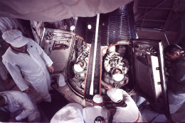 Astronauts Virgil Grissom, left, and John Young settle into the Gemini 3 capsule at Cape Kennedy, Florida, March 23, 1965.  They piloted the first space craft to change its orbital path.  (AP photo)