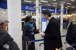 A Eurostar representative gives advice to a traveler after services were suspended on the Brussels Eurostar train route because of the attacks in Belgium, at St Pancras international railway station in London, Tuesday, March 22, 2016. Explosions, at least one likely caused by a suicide bomber, rocked the Brussels airport and subway system Tuesday, prompting a lockdown of the Belgian capital and heightened security across Europe. (AP Photo/Matt Dunham)