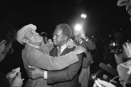 Joseph Yeldell, right, who formerly headed the District's Department of Human Resources, embraces an unidentified man at the District of Columbia Building in Washington on Friday, March 11, 1977 after the man was released by terrorists who had held a group in the building since Wednesday. (AP Photo)
