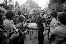 Officials remove the body of actor-comedian John Belushi from a bungalow at the Chateau Marmont hotel in Los Angeles, Ca., where Belushi's body was found dead, Friday, March 5, 1982.  Belushi, 33, died of an accidental drug overdose.  (AP Photo/Lennox McLendon)