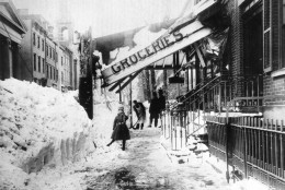 """The awning of a grocery store is damaged from the weight of the snow during the blizzard of 1888 in New York City.  The blizzard on March 12-14 paralyzed the city with about 40"""" of snow and winds that reached up to 60 miles per hour, creating drifts as high as fifty feet.  (AP Photo)"""