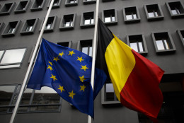 The European and the Belgian national flag set on half staff  after terrorist attacks in Brussels in front of the Belgium Embassy in Berlin, Germany, Tuesday, March 22, 2016. (AP Photo/Markus Schreiber)