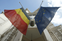 The Belgian Embassy in central  London, with the country's national flag and the flag of the European Union at half staff following the attacks in Brussels, Tuesday, March, 22, 2016. Authorities in Europe and beyond have tightened security at airports, on subways, at the borders and on city streets after deadly attacks Tuesday on the Brussels airport and its subway system. (AP Photo/Alastair Grant)