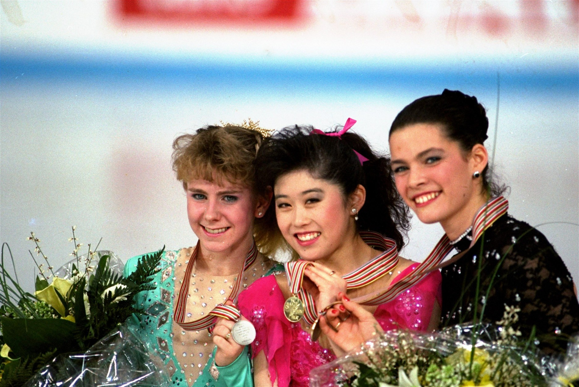 American skaters (L to R) Tonya Harding, silver; Kristi Yamaguchi, gold; and Nancy Kerrigan, bronze, display their medals after the finals of the World Figure Skating Championships in Munich, Saturday, March 12, 1991. (AP Photo/Diether Endlicher)