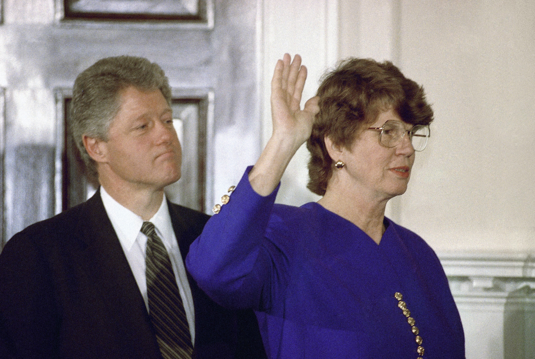 While President Bill Clinton looks on, Janet Reno takes the oath as attorney general during a ceremony at the White House in Washington on March 12, 1993. Supreme Court Justice Byron White administered the oath to Reno who became the nation's first female attorney general. (AP Photo/Barry Thumma)