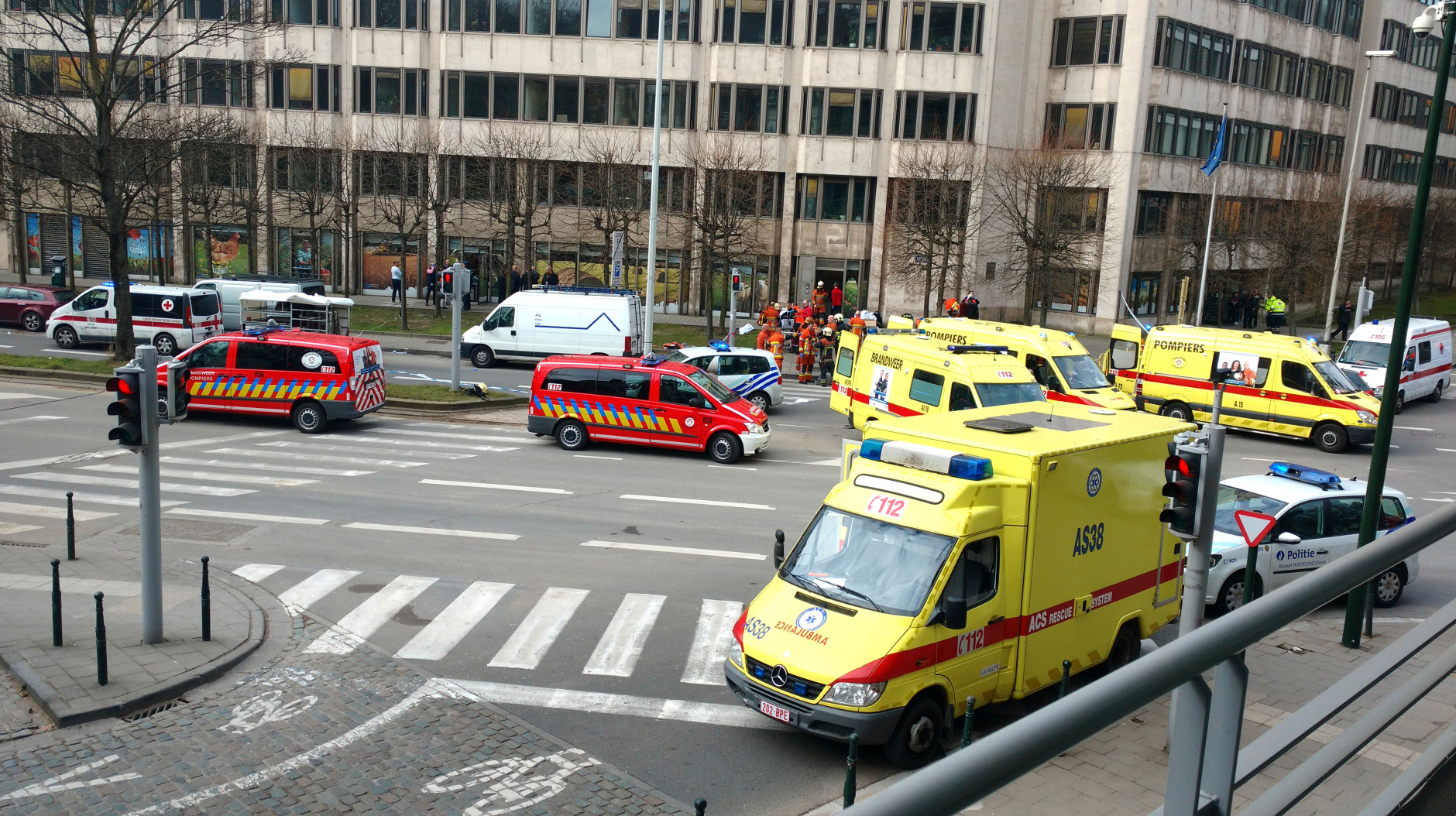 Emergency services after a explosion in a main metro station in Brussels on Tuesday, March 22, 2016. Explosions rocked the Brussels airport and the subway system Tuesday, killing at least 13 people and injuring many others just days after the main suspect in the November Paris attacks was arrested in the city, police said. (AP Photo/Sylvan Plazy)