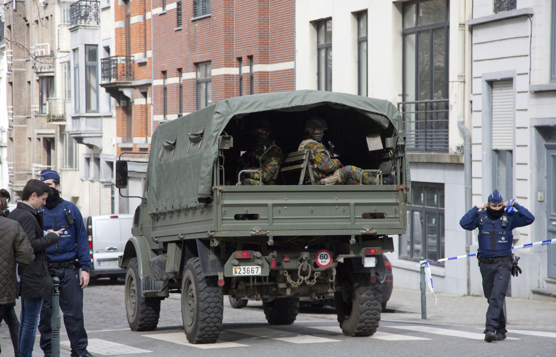 A truck carrying soldiers of the Belgian Army arrives after a explosion in a main metro station in Brussels on Tuesday, March 22, 2016. Explosions rocked the Brussels airport and the subway system Tuesday, killing at least 13 people and injuring many others just days after the main suspect in the November Paris attacks was arrested in the city, police said. (AP Photo/Virginia Mayo)