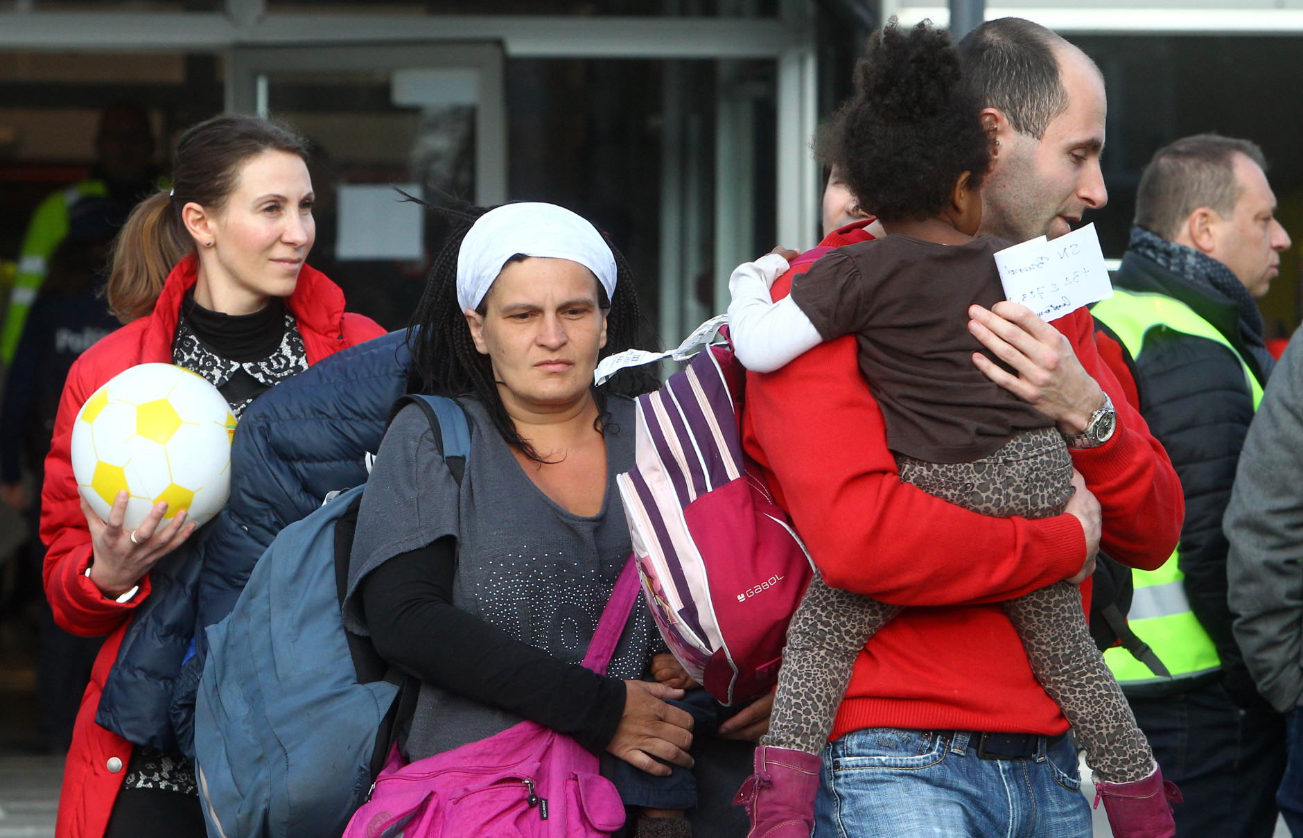 Passengers leave a gym where they took shelter after the explosions, near  the  Zaventem Airport in Brussels, Tuesday, March 22, 2016. Bombs struck the Brussels airport and one of the city's metro stations Tuesday, killing and wounding dozens of people, as a European capital was again locked down amid heightened security threats. (AP Photo/Michel Spingler)