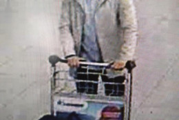 In this image provided by the Belgian Federal Police in Brussels on Tuesday, March 22, 2016, a man who is suspected of taking part in the attacks at Belgium's Zaventem Airport and is being sought by police. Bombs exploded at the Brussels airport and one of the city's metro stations Tuesday, killing and wounding scores of people, as a European capital was again locked down amid heightened security threats. (Belgian Federal Police via AP)