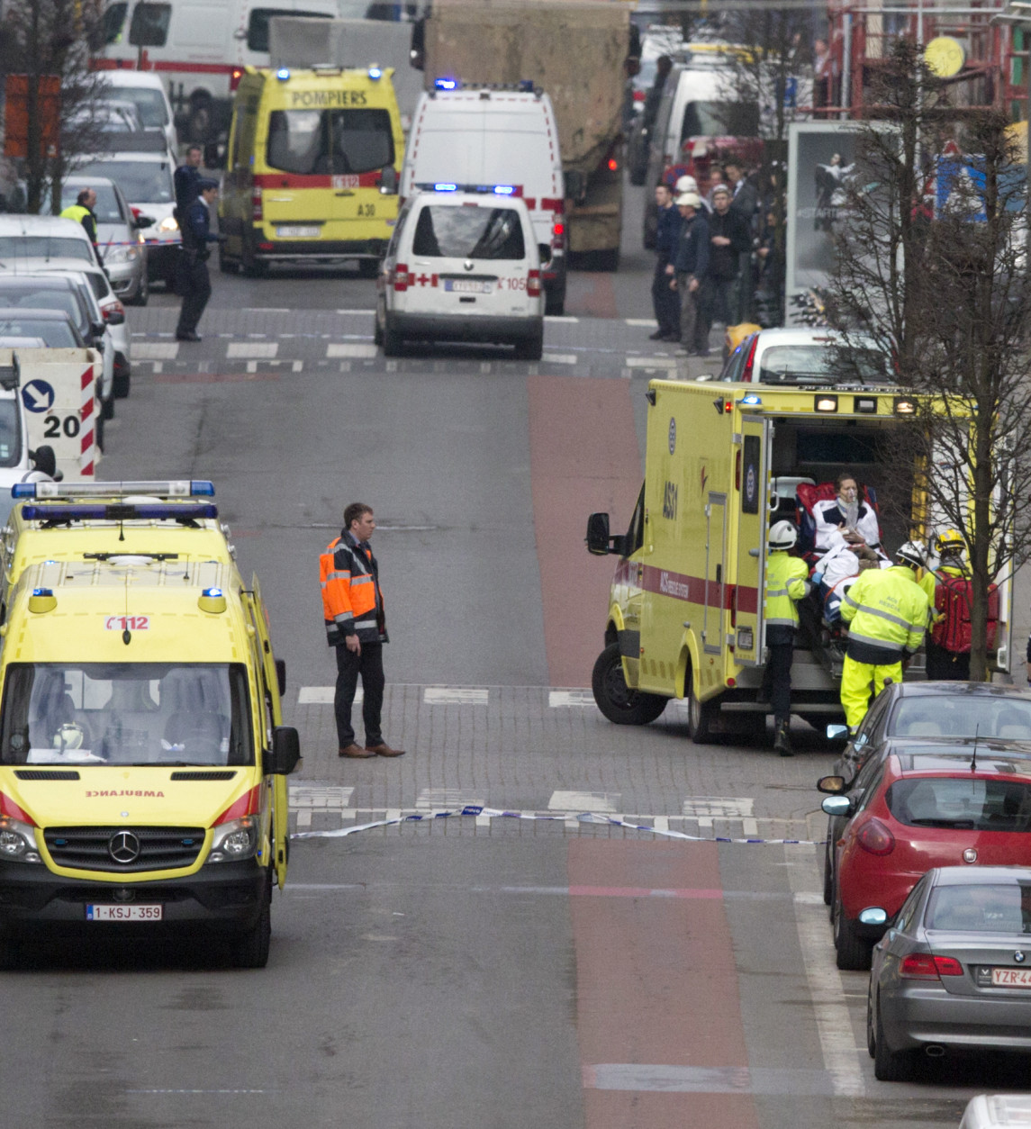 A woman is evacuated in an ambulance by emergency services after a explosion in a main metro station in Brussels on Tuesday, March 22, 2016. Explosions rocked the Brussels airport and the subway system Tuesday, killing at least 13 people and injuring many others just days after the main suspect in the November Paris attacks was arrested in the city, police said. (AP Photo/Virginia Mayo)