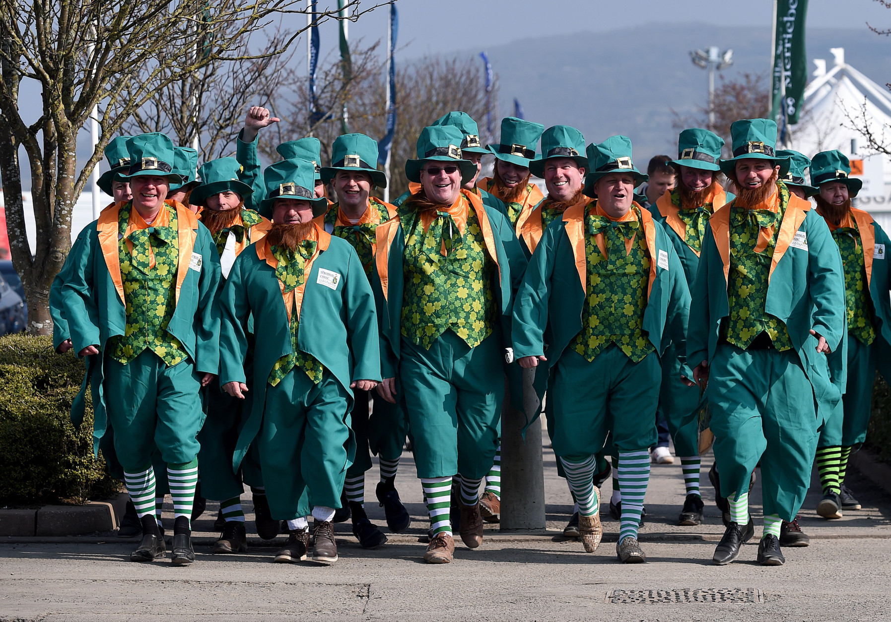 Racegoers dressed in fancy dress arrive  at Cheltenham Racecourse in Cheltenham England on St Patrick's Thursday March 17, 2016.  Cheltenham always attracts a large number Irish people to the Cheltenham Horse Racing Festival.(Joe Giddens/PA via AP) UNITED KINGDOM OUT