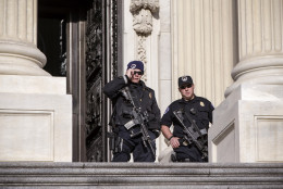 U.S. Capitol Police officers stand guard outside at the entrance to the House of Representatives on Capitol Hill in Washington, Tuesday, March 22, 2016. Deadly explosions ripped through the Brussels airport and a subway station Tuesday during the morning rush hour, only days after the prime suspect in the Paris terror attacks Salah Abdeslam was arrested in Brussels.  (AP Photo/J. Scott Applewhite)