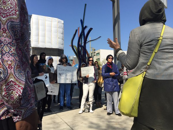Protest held outside Shaw Library after woman ordered to remove hijab