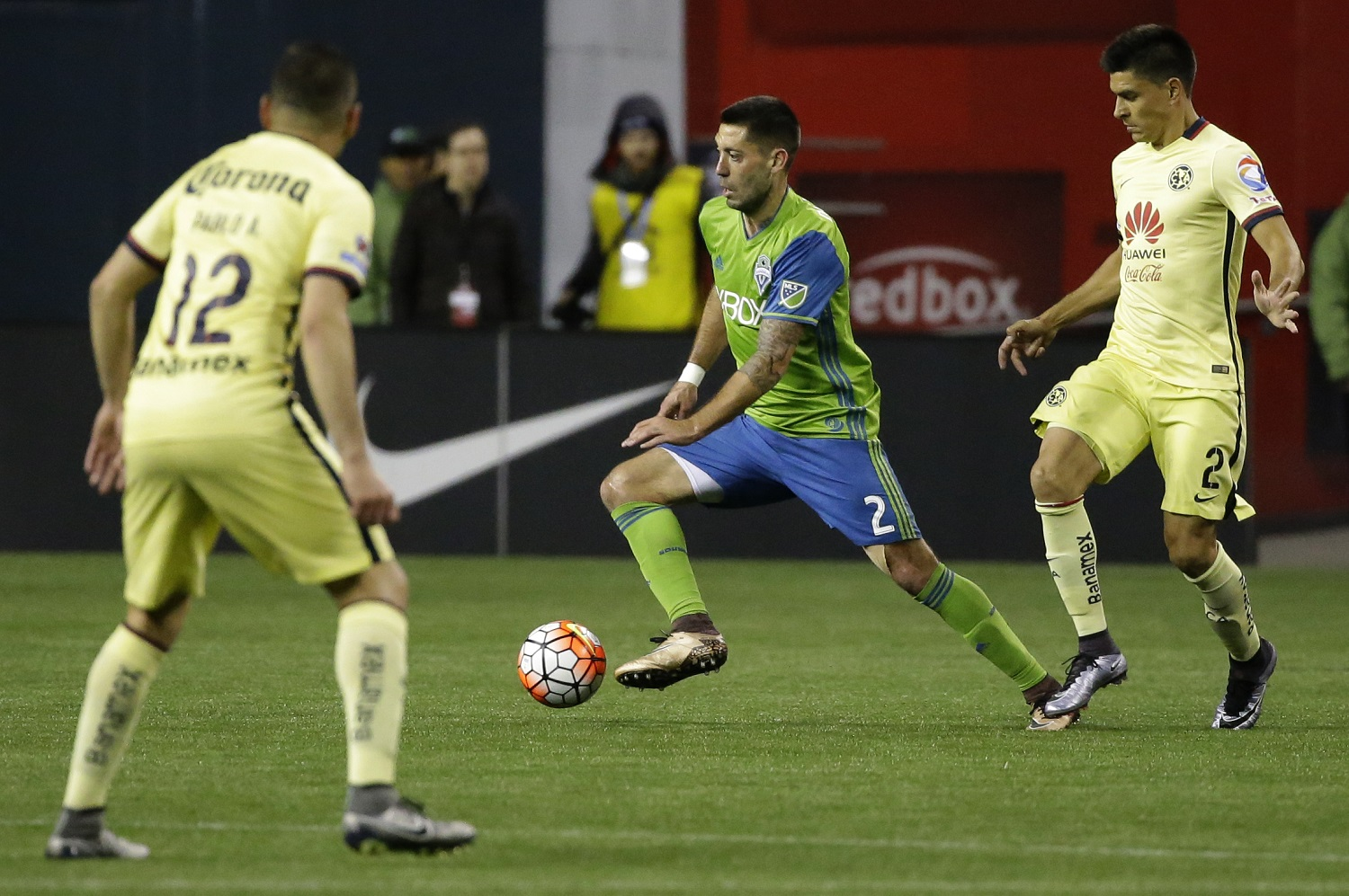 Seattle Sounders forward Clint Dempsey, center, works between Club America's Pablo Aguilar, left, and Paolo Goltz during the second half of a CONCACAF Champions League soccer quarterfinal, Tuesday, Feb. 23, 2016, in Seattle. The match ended in a 2-2 draw. (AP Photo/Ted S. Warren)