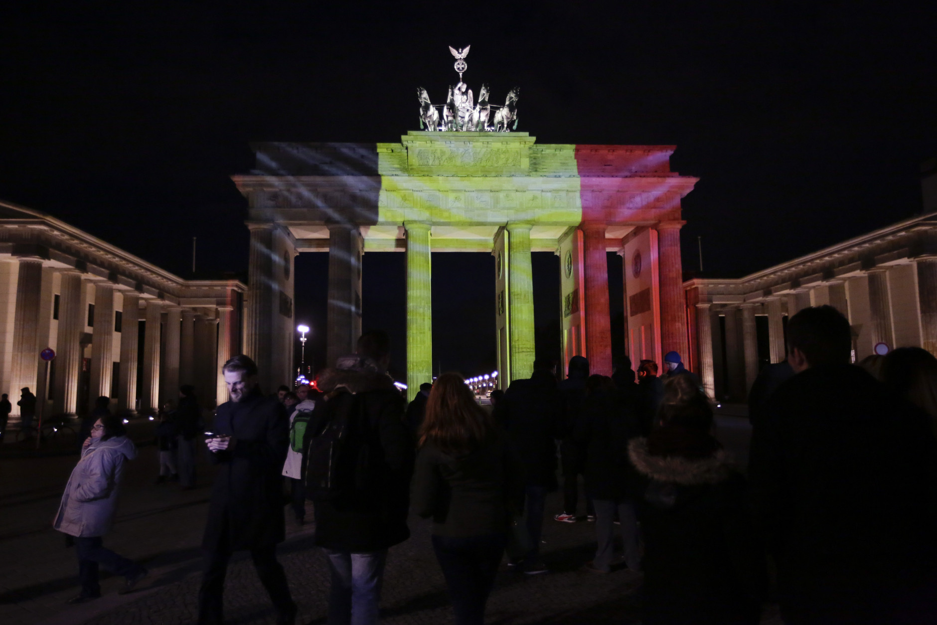 The Brandenburg Gate is illuminated with the Belgium national flag in reaction to the Brussels attacks, in Berlin, Germany, Tuesday, March 22, 2016. (AP Photo/Markus Schreiber)