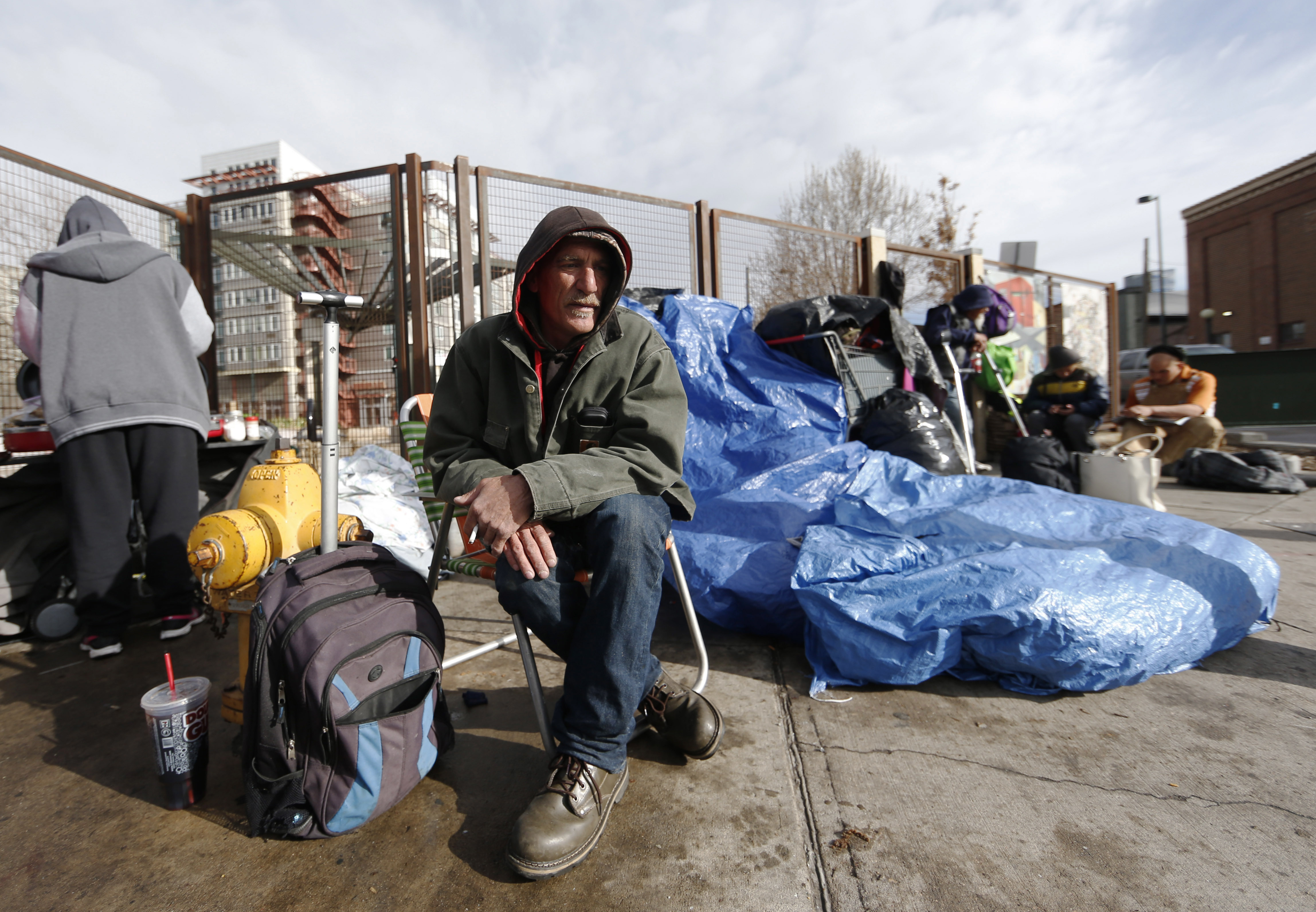 The Latest: Denver homeless gather possessions after ...