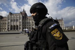A member of the Counter Terrorism Centre (TEK) patrols the area in front of the Parliament in downtown Budapest, Hungary, Tuesday, March 22, 2016. Hungary raised its terrorism awareness level to grade 2 after a series of attacks in Brussels. (Zoltan Balogh/MTI via AP)