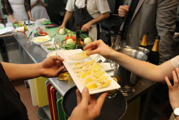 Since paella takes a decent amount of time to cook properly, theclass is offered various small bites from the Jaleo menu while working. Pictured: Endives topped with goat cheese, orange pieces and almonds. (WTOP/Dana Gooley)