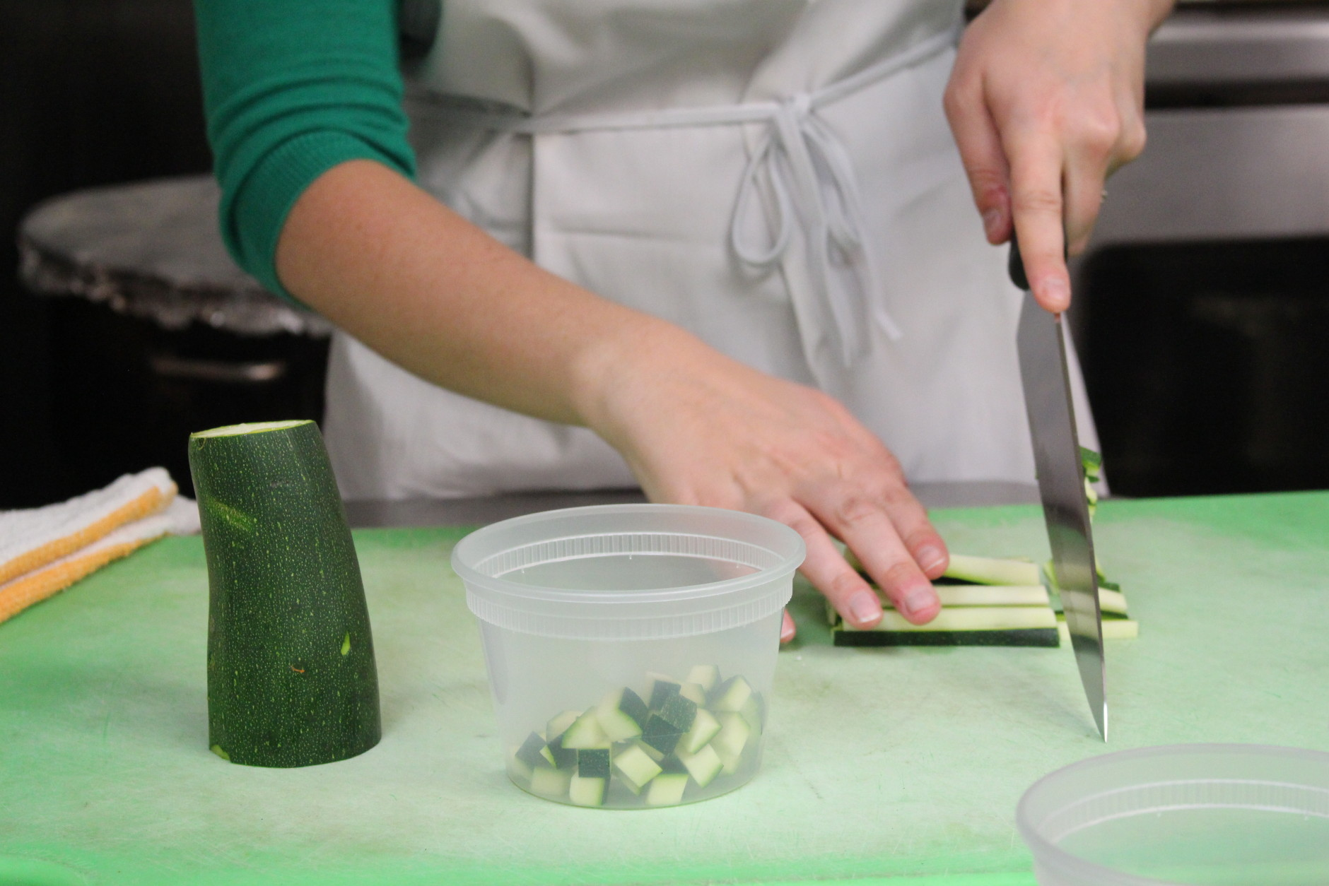 Crisp zucchini adds a pop of color to the paella ingredients. (WTOP/Dana Gooley)