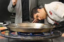 When it's time to start cooking, Meltzer hauls out a massive tabletop burner with three rings of flame. He says manipulating and controlling the flame, or heat, depending on what you're cooking on, will always be the most important part of the process.. (WTOP/Dana Gooley)