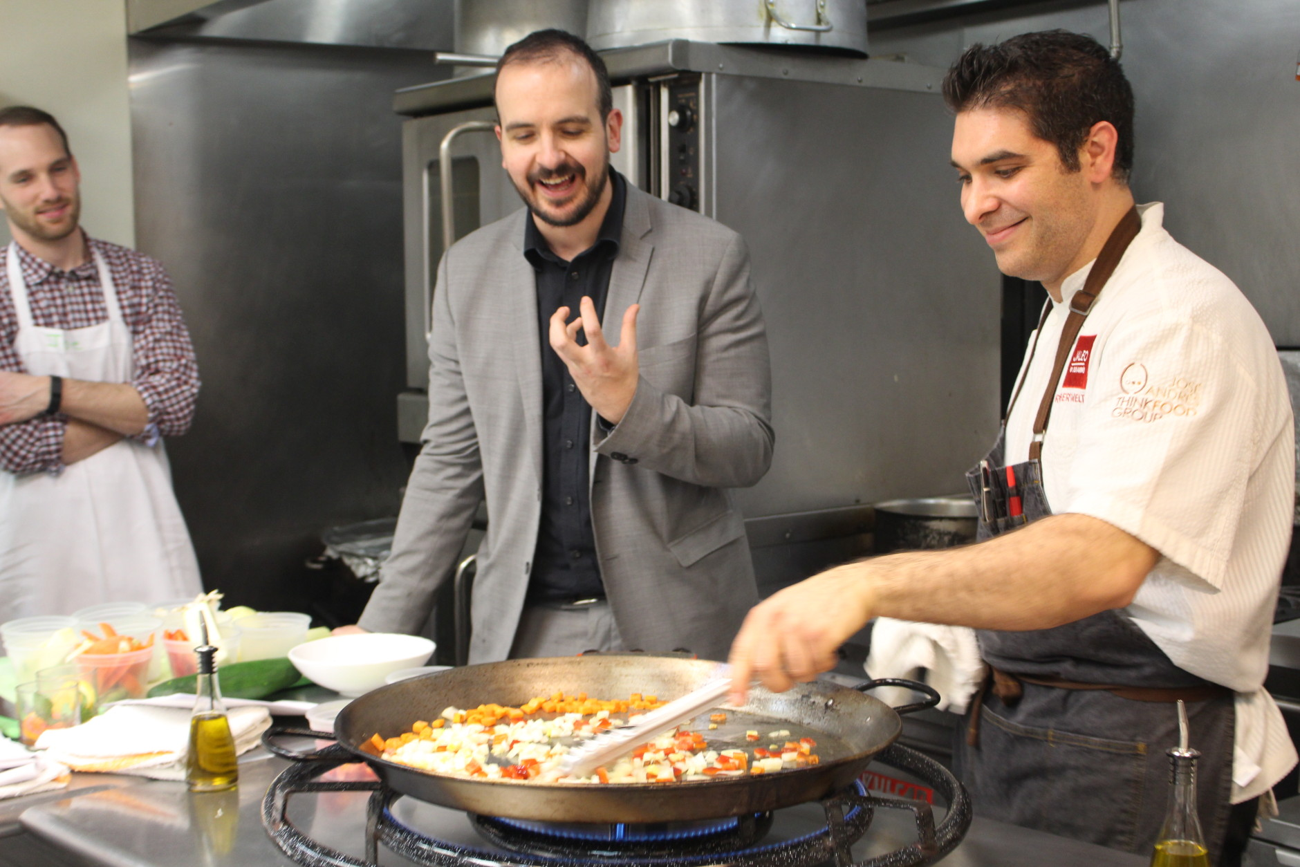 When making paella, add the vegetables with the least water content first, because they will take the longest to cook. Carrots went in first, followed by onions, with zucchini, leeks and mushrooms waiting on the side. (WTOP/Dana Gooley)