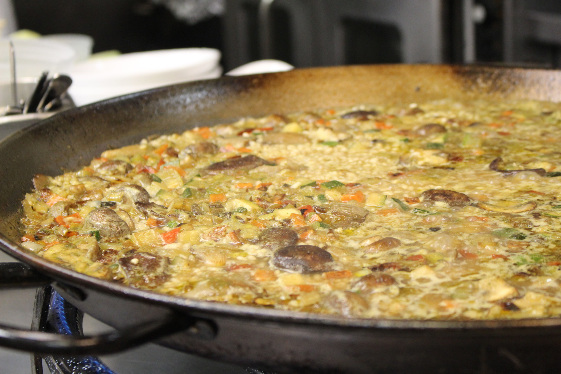 As the rice absorbs the stock, the pan will start to thicken up. It should go from the consistency of soup to a thick, creamy stew. (WTOP/Dana Gooley)
