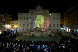 The Belgian flag is projected on Rome's historical Trevi Fountain to honor the victims of the deadly attacks at Brussels airport and subway, Tuesday, March 22, 2016. Explosions, at least one likely caused by a suicide bomber, rocked the Brussels airport and its subway system prompting a lockdown of the Belgian capital and heightened security across Europe. (AP Photo/Andrew Medichini)