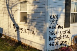 "Last week, Beaty says she found her house spray painted with the words ""revolution"" and ""can you see the new world through the tear gas."""