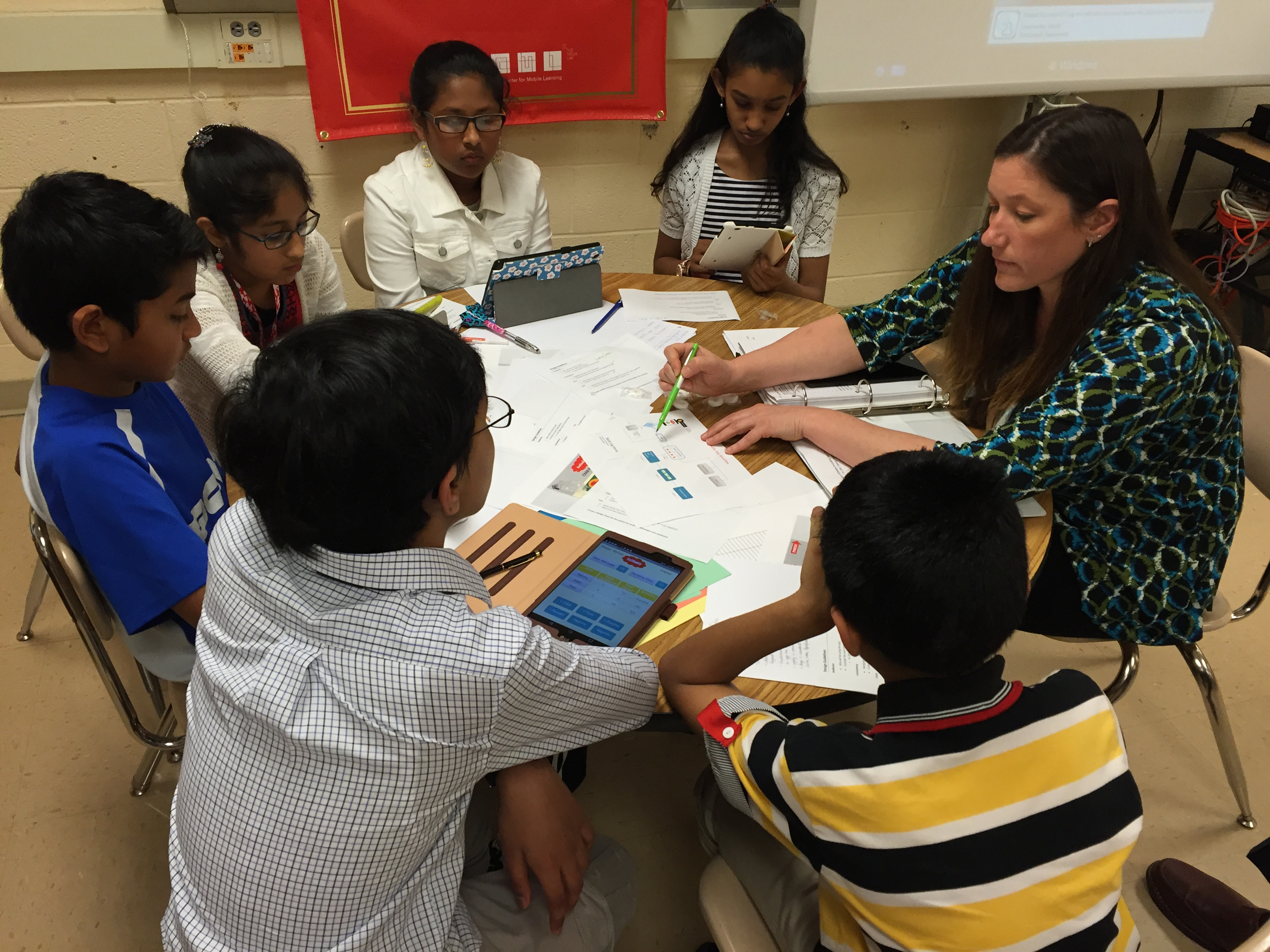 Local students take on task of building app for autistic kids