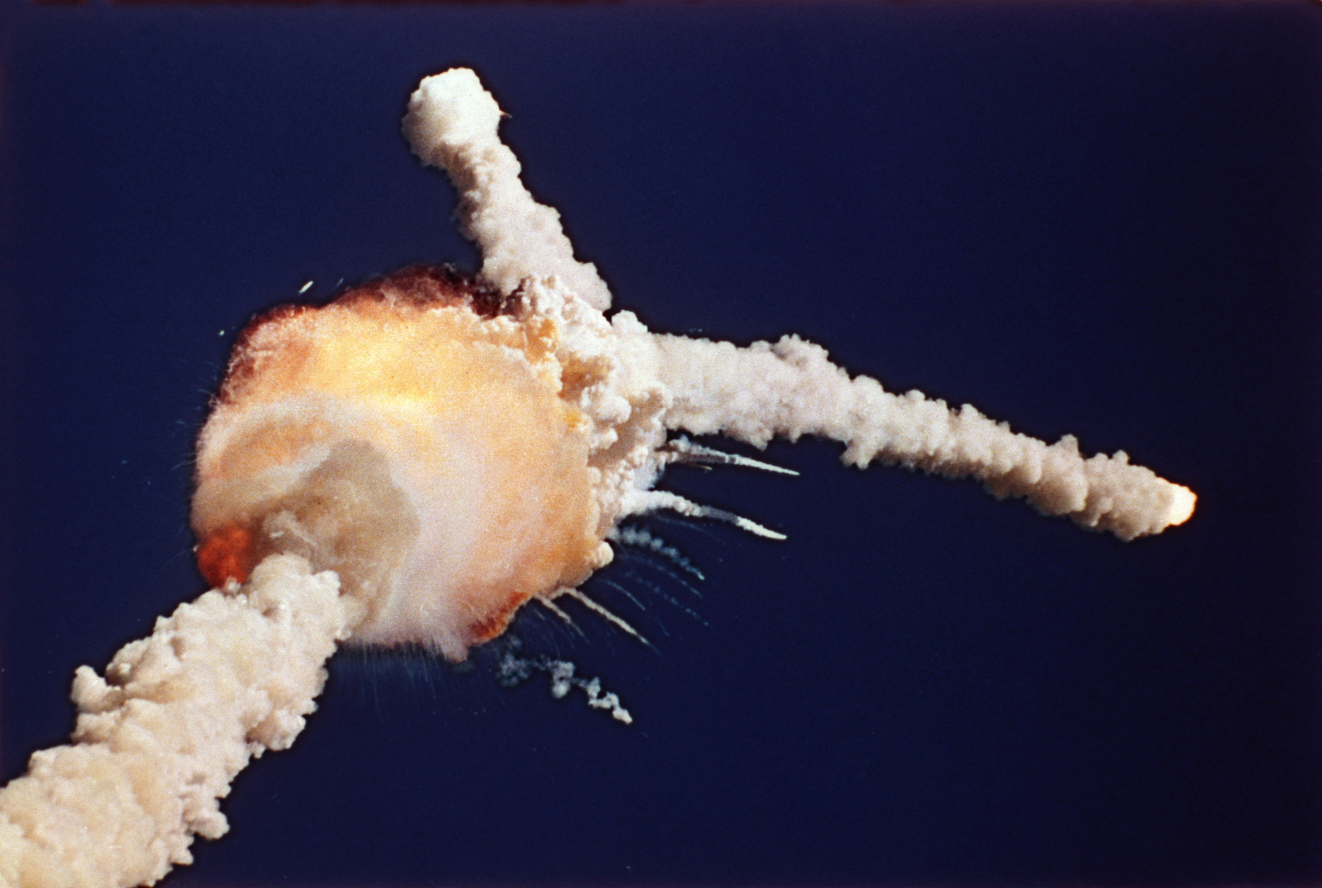 FILE - In this Jan. 28, 1986 file photo, the Space Shuttle Challenger explodes shortly after lifting off from Kennedy Space Center, in Fla. All seven crew members died in the explosion, which was blamed on faulty o-rings in the shuttle's booster rockets. Bob Ebeling had spent three decades filled with guilt over not stopping the explosion of Challenger, but found relief in the weeks before his death Monday, March 21, 2016, at age 89. NPR reports Ebeling had been a booster rocket engineer at a NASA contractor during the launch. He tried to convince them to postpone it, saying the cold temperatures could cause the shuttle to explode. (AP Photo/Bruce Weaver, File)
