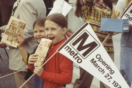 Two young girls excitedly stand among the crowd on the opening day of the Rhode Island Avenue Metro station on  March 27, 1976.  (WMATA/Paul Myatt)