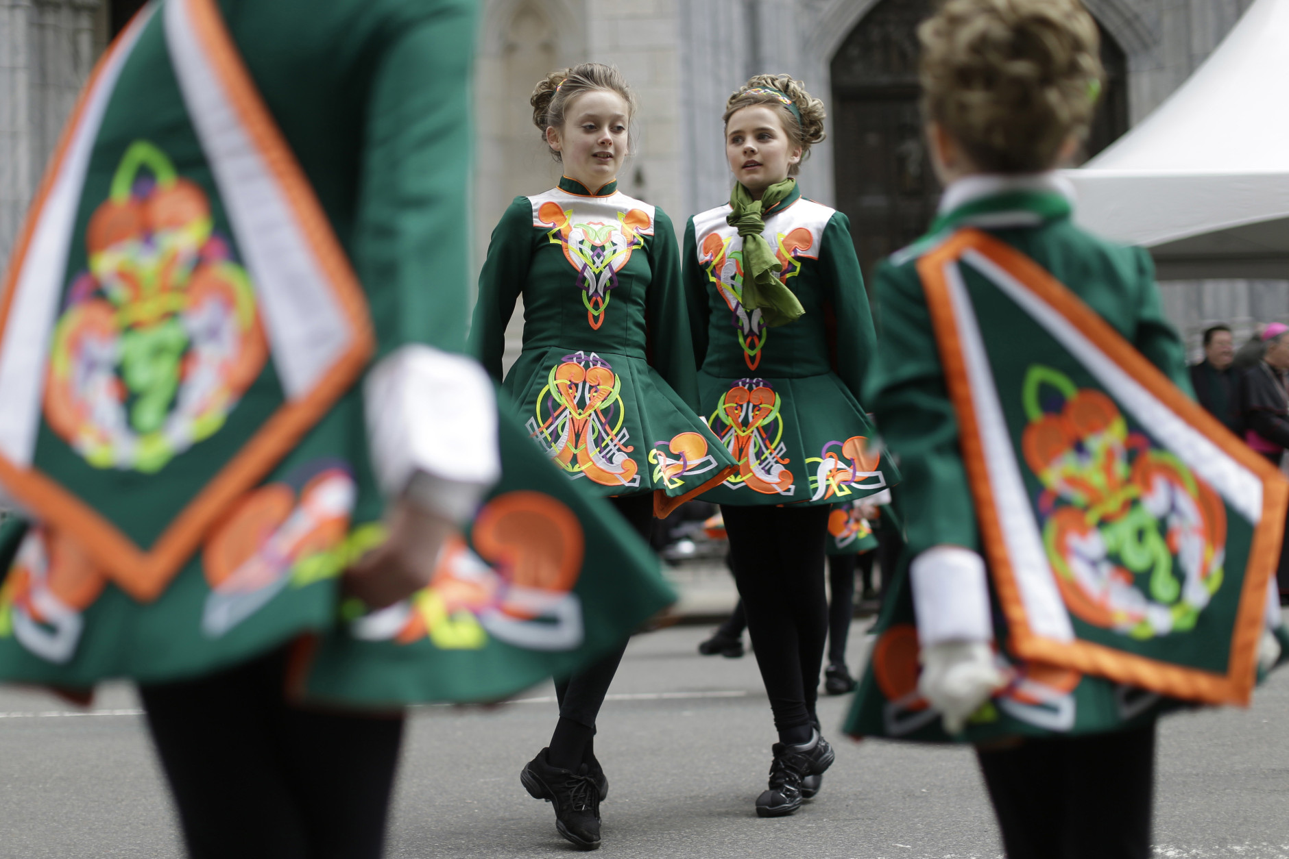FILE - In this March 17, 2015 file photo, girls perform a traditional Irish step dance as they march up Fifth Avenue during the St. Patrick's Day Parade in New York. The parade traces its history to 1762 and has about 200,000 marchers. (AP Photo/Mary Altaffer, File)