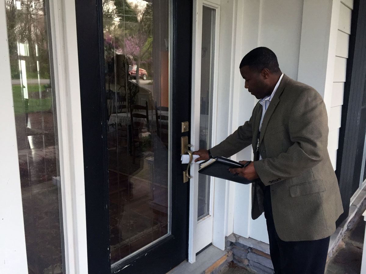Police canvass waterfront neighborhood for information on fatal shooting