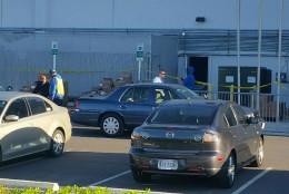 Police tape is seen around the Reinhart building. (WTOP/Kathy Stewart)