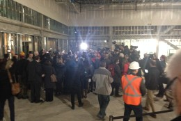 Showing the press into the uncompleted ballroom, Donald Trump was surrounded with reporters who had questions. (WTOP/Megan Cloherty)