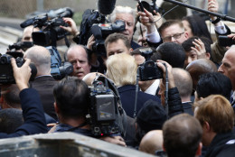 Republican presidential candidate Donald Trump, center, is surrounded by the media after a tour of the Old Post Office Pavilion, soon to be a Trump International Hotel, Monday, March 21, 2016, in Washington. (AP Photo/Alex Brandon)