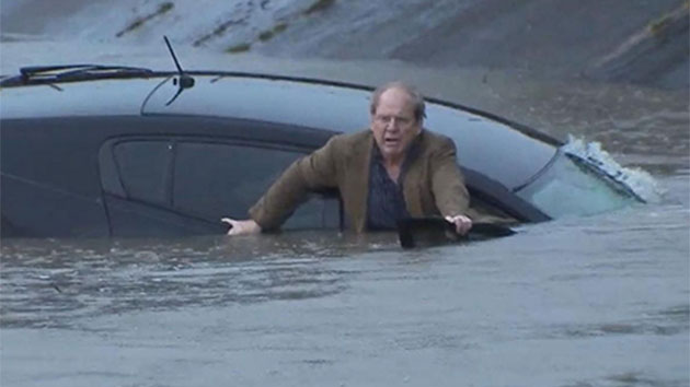 Man trapped in sinking car rescued by reporter on live TV (Video)