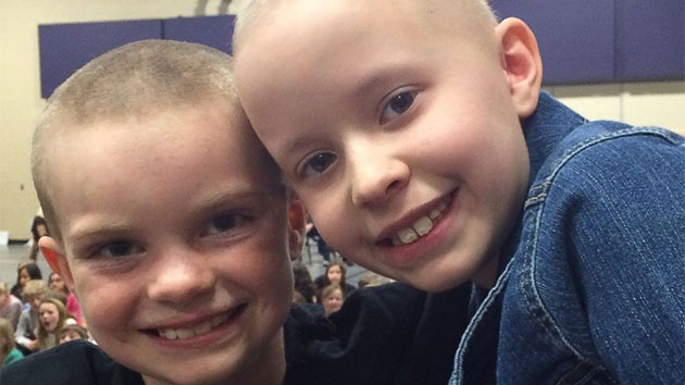 School holds mass shaving to support 9-year-old student with cancer