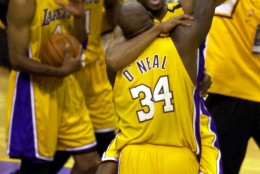 Los Angeles Lakers' Kobe Bryant and Shaquille O'Neal hug and lift their arms in victory after taking the NBA Championship in six games with a 116-111 win over the Indiana Pacers in Los Angeles Monday, June 19, 2000. (AP Photo/Michael Caulfield)