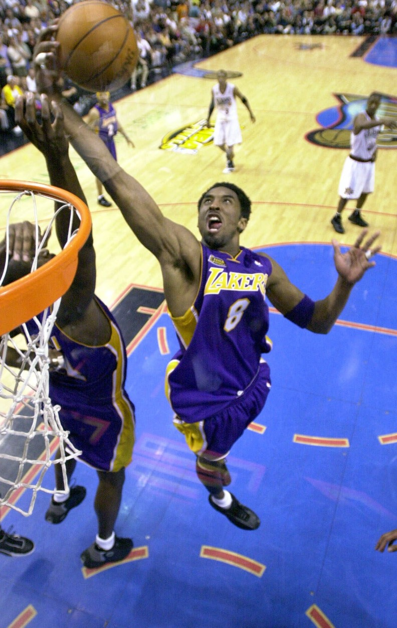 Los Angeles Lakers' Kobe Bryant goes up for a rebound in the fourth quarter against the Philadelphia 76ers' in game 5  of the NBA finals Friday June 15, 2001 in Philadelphia.  The Lakers won their second straight NBA championship, defeating the 76ers 108-96 to clinch the best-of-seven series 4-1.(AP Photo/Mark J. Terrill,  Pool)