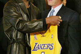 Los Angeles Lakers guard Kobe Bryant holds up a team jersey to the chest of President Bush during a ceremony for the 2001 NBA World Champions in the East Room of the White House, Monday, Jan. 28, 2002. (AP Photo/Doug Mills)