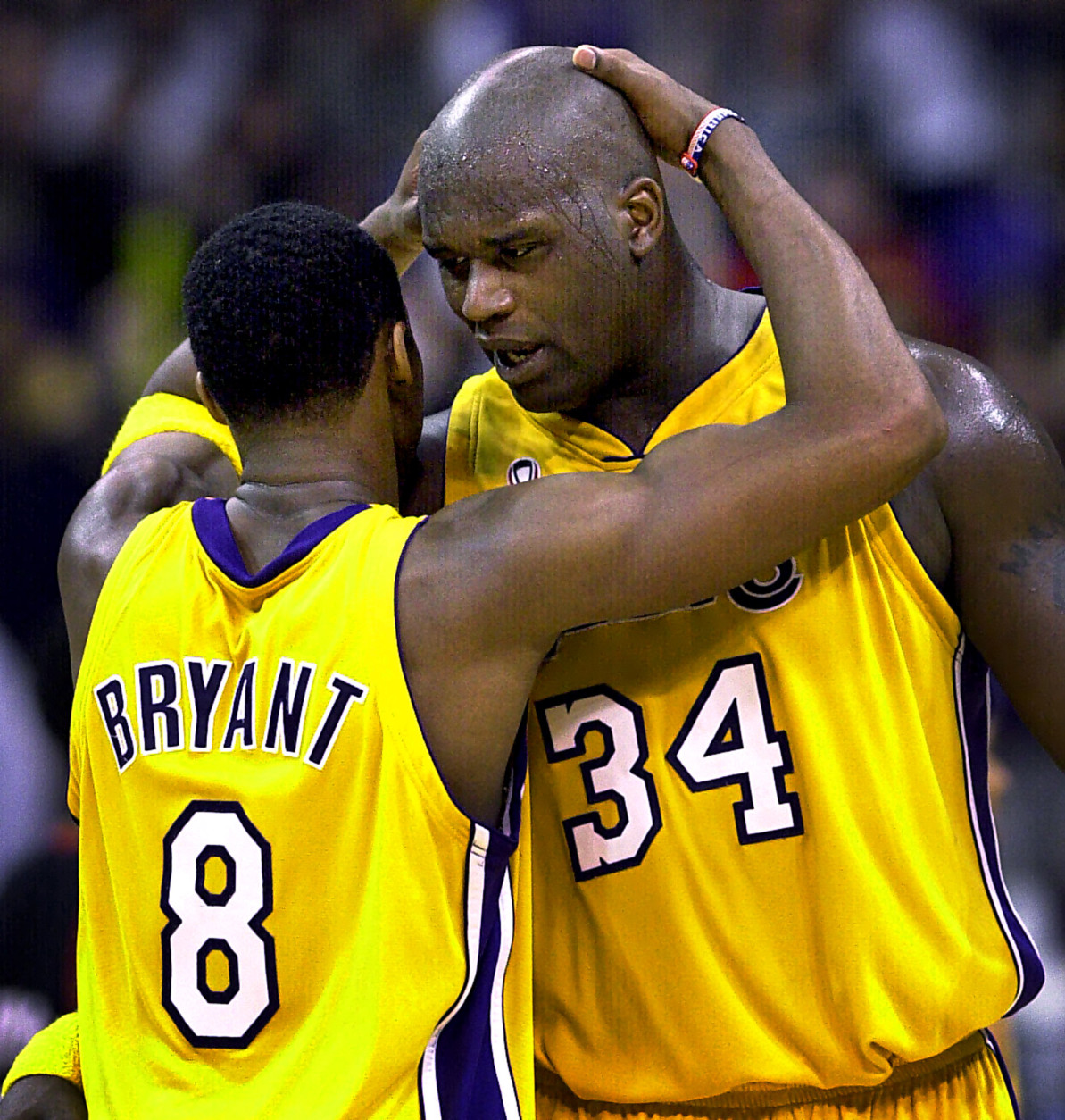 """FILE-This April 21, 2002 file photo shows Los Angeles Lakers's Kobe Bryant, left, and Shaquille O'Neal embracing in the closing minutes in Game 1 of their best-of-five first-round Western Conference playoff series against the Portland Trail Blazers in Los Angeles.  O'Neal says on Twitter  Wednesday June 1, 2011,that he's """"about to retire."""" O'Neal sent a Tweet shortly before 2:45 p.m. saying, """"im retiring."""" It included a link to a 16-second video in which he says, """"We did it; 19 years, baby. Thank you very much. That's why I'm telling you first: I'm about to retire. Love you. Talk to you soon."""" (AP Photo/Mark J. Terrill,File)"""