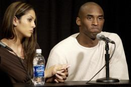 Los Angeles Lakers star Kobe Bryant holds the hand of his wife Vanessa as he pauses during a news conference Friday, July 18, 2003, at the Staples Center in Los Angeles. Bryant was charged Friday with sexually assaulting a 19-year-old woman in a case bound to tarnish the career of one of the NBAs brightest young superstars. Bryant denied the charge, saying he was guilty only of adultery. (AP Photo/Kevork Djansezian)