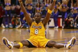 Los Angeles Lakers' Kobe Bryant reacts after hitting the game-winning basket in the Lakers' 101-99 win over the Denver Nuggets on Friday, Dec. 19, 2003, in Los Angeles. Bryant was in court for a pretrial hearing on his sexual assualt charge in Eagle, Colo., earlier Friday and missed the first quarter. (AP Photo/Chris Carlson)