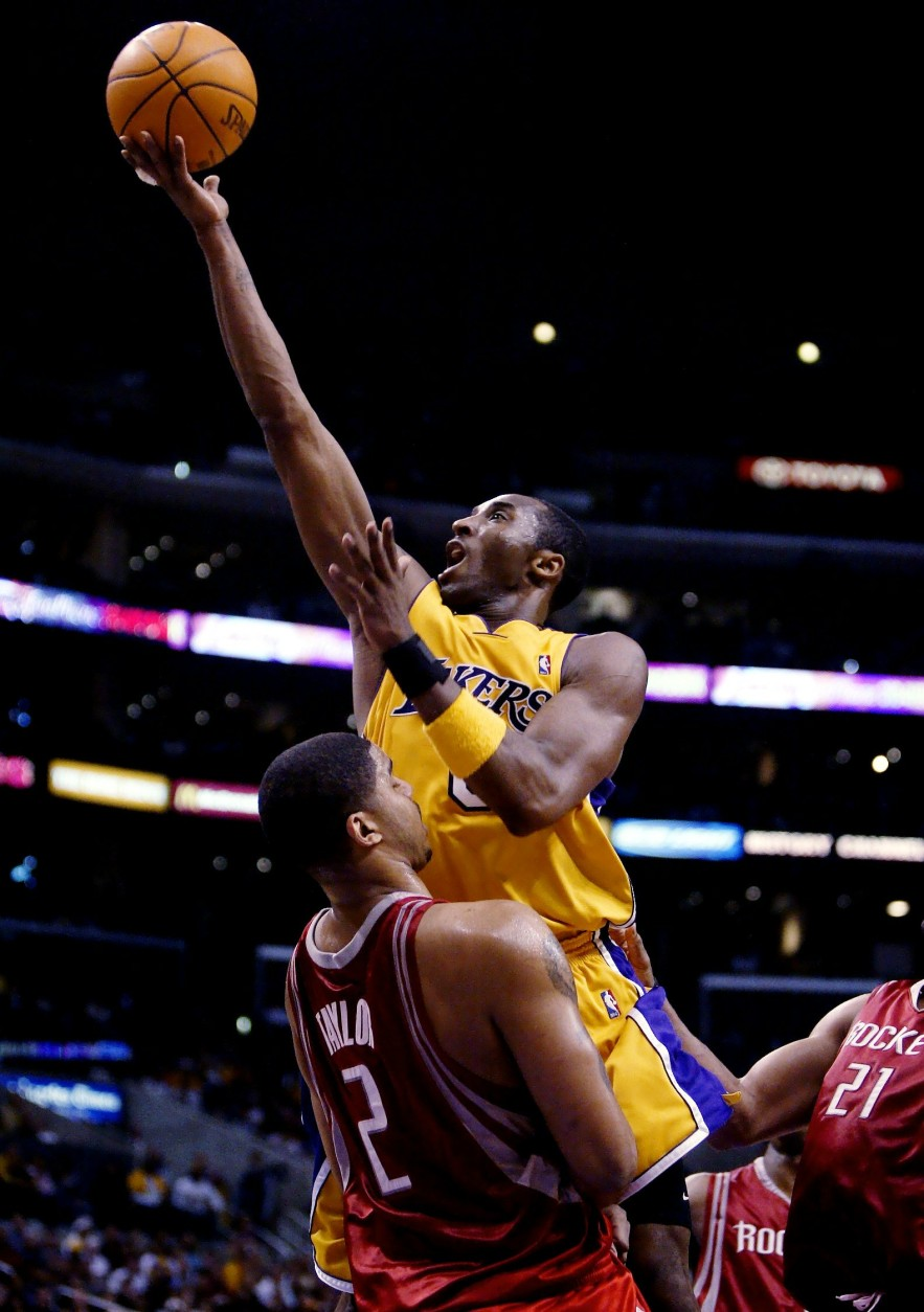 Los Angeles Lakers' Kobe Bryant, top, goes up for a layup against Houston Rockets' Maurice Taylor during the fourth quarter of a first-round Western Conference NBA playoff game Saturday, April 17, 2004, at Staples Center in Los Angeles. Bryant scored 16 points in the Lakers' 72-71 win. (AP Photo/Kevork Djansezian)