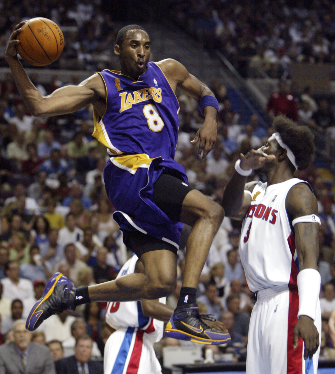 Los Angeles Lakers Kobe Bryant (8) goes by Detroit Pistons Ben Wallace (3) in the first half of  Game 5 of the NBA Finals in Auburn Hills, Mich. Tuesday night June 15, 2004. (AP Photo/ Paul Sancya )
